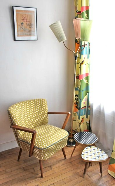mid century modern chair with mustard polka dots highlight mid century modern side table with multicolored surfaces