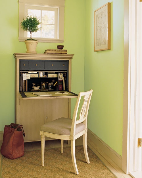 mini corner home office idea light neutral dressing like working desk light grey chair light green painted walls
