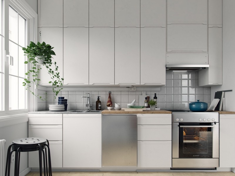 minimalist Scandinavian kitchen flat paneled kitchen cabinets with chrome accents metal oven hanging plant smaller block butcher countertop white subway backsplah