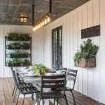 Outdoor Dining Space In Modern Farmhouse Black Finished Metal Dining Furniture Wall Rack In Black Rack Mounted Pots Industrial Lighting Fixtures