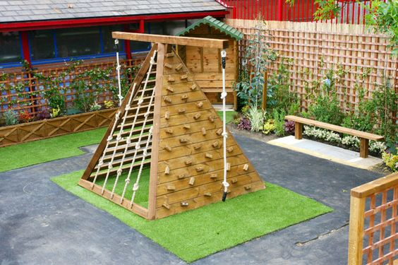 outdoor playground idea wood tent green grass carpet concrete flooring flowery fencing system