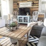 Rustic Farmhouse Living Room Reclaimed Wood Shiplap Walls Light Blue TV Cabinet White Chairs Gray Couch White Blanket Wood Board Coffee Table