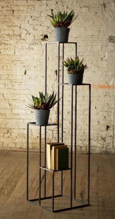 rustic plant stands made of black wrought iron some shabbily bold pots