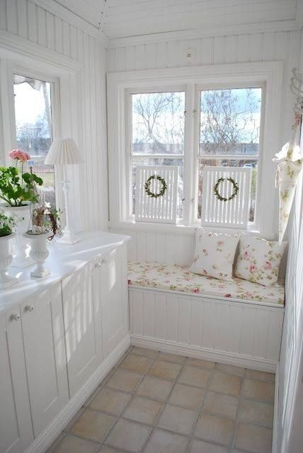 seating nook in vintage style bay window with vintage bench cemen tiled floors