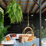 Seating Nook Painted Tiles Floors Rattan Hang L Shaped Couch In White Multicolored Throw Pillows Black Painted Pallet Walls Hanging Plants