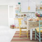Shabby Chic Dining Room Whitewashed Cabinets Pop Of Colored Dining Chairs Fabric Rug With Textural Color Vintage Print Linens