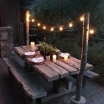 Simple Warm Outdoor Dining Space Rustic Dining Furniture With String Light
