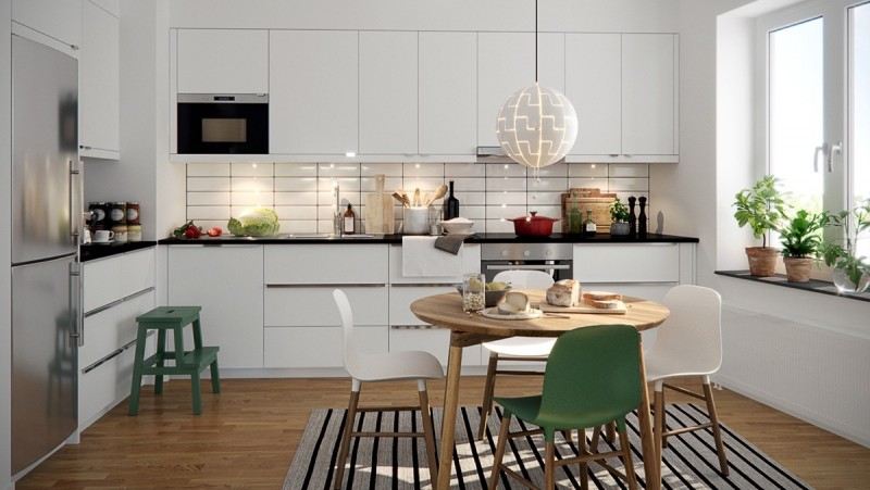 small Scandinavian kitchen white flat paneled cabinets light wood floors light wood dining table with round top Scandinavian style chairs striped area rug bulb pendant in white