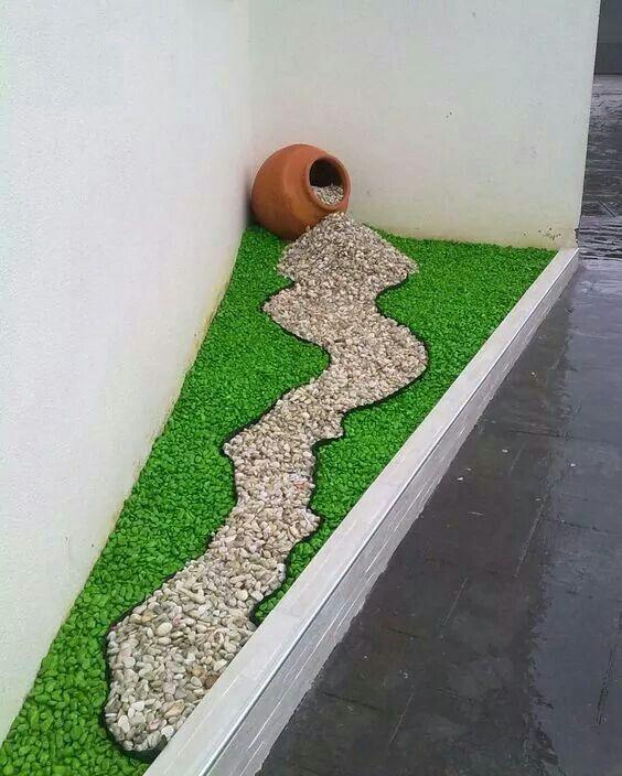 stone spilled garden ornament in grass bed