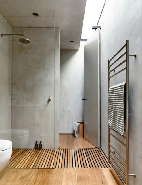 urban industrial bathroom design with wood element glass paneled walk in shower