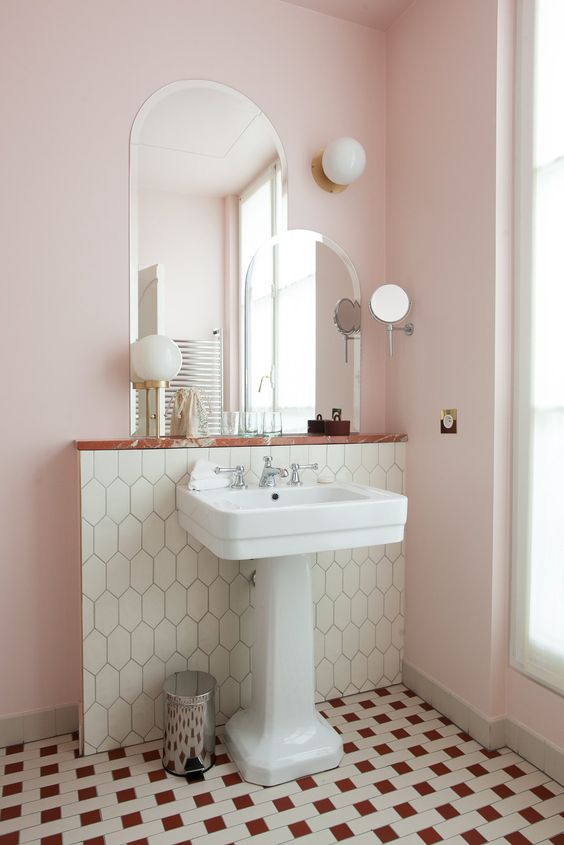 white pedestal sink with faucet modern tiles floors tiles walls curved top mirrors light pink walls