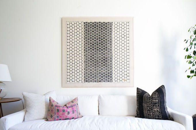 white sofa vintage textile covered throw pillows framed textile wall decor
