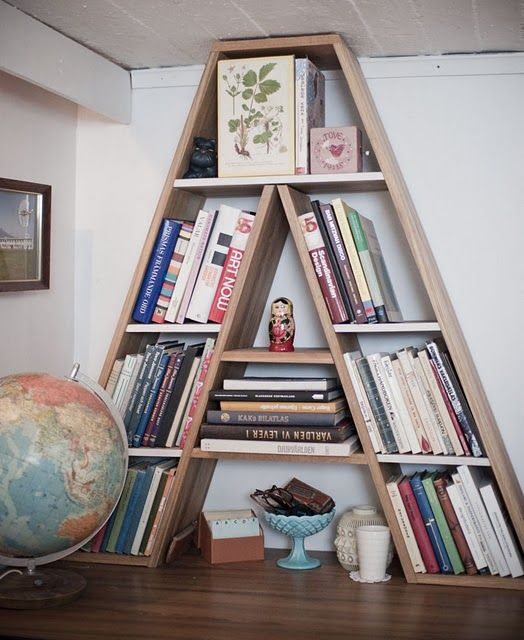 A shaped bookcase made of wood