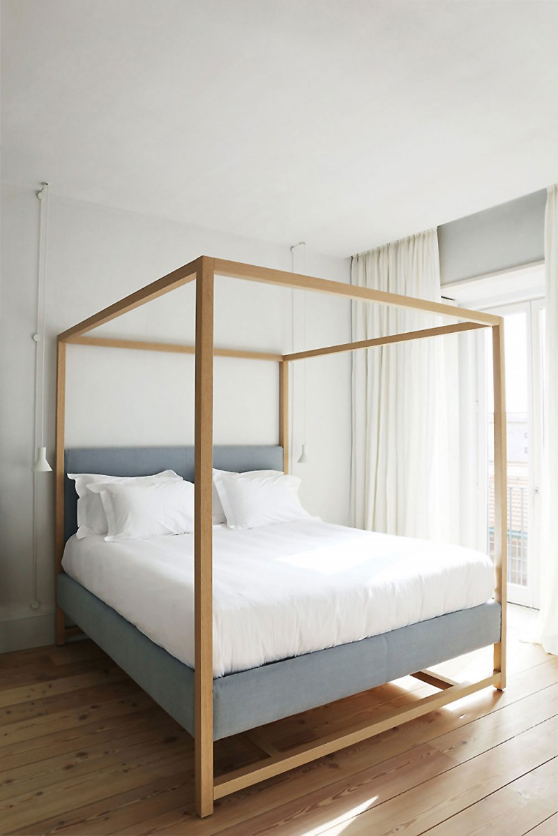 bed with wood canopy white bedding treatment wood board floors white curtains