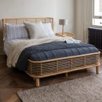 Classic Rattan Bed Frame Striped Bed Linen Woven Blanket In White Textured Duvet In Dusty Blue