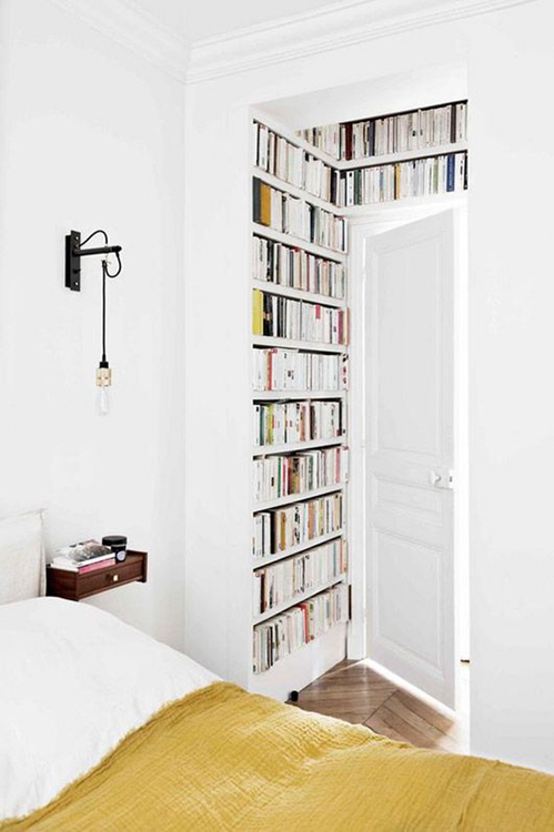 mini bedroom library lining the alcove