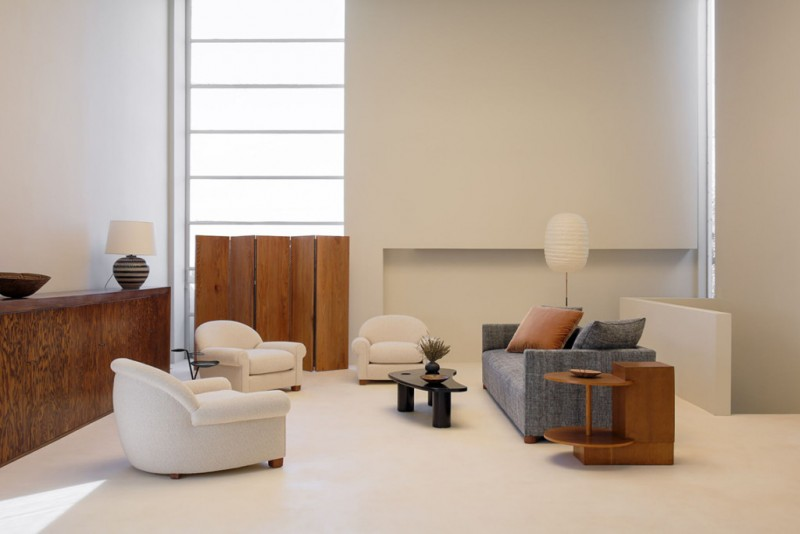 modern minimalist living room white chairs modern sofa in gray wooden side table in unique shape clean lined hall buffet