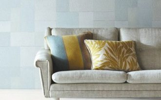muted duck egg colored wallcovering product light gray couch with throws