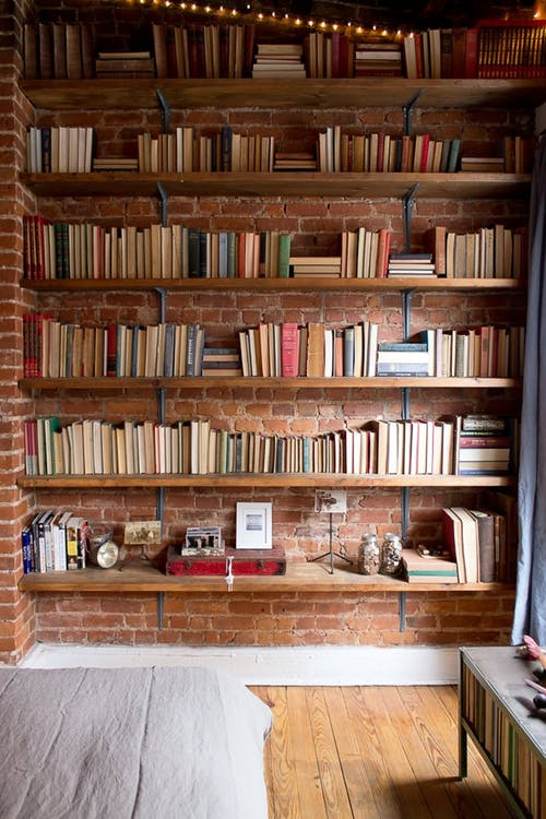 recessed book shelves with red brick surround