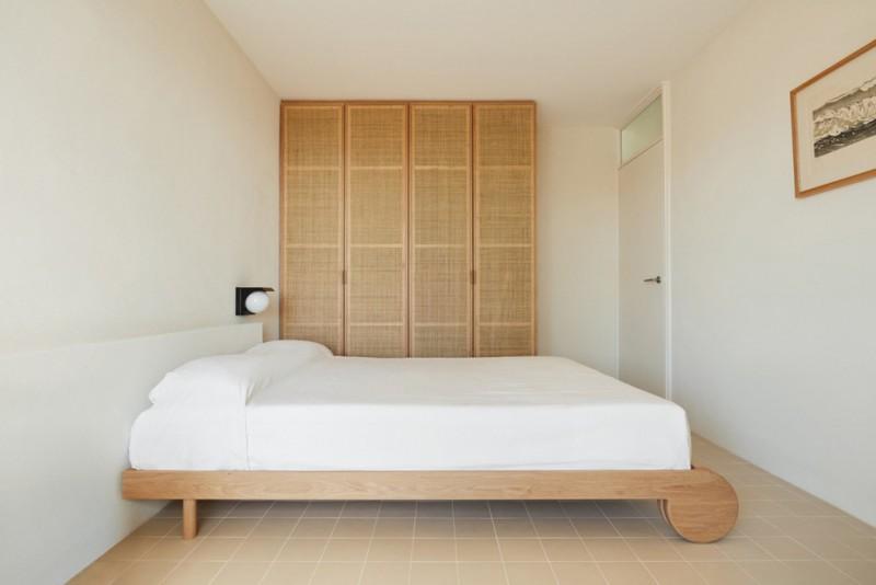 simple and minimalist bedroom design light wood bed frame white bedding treatment light wood closet white walls light cream tile floors