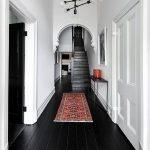 Simple Modern Hallway Moroccan Runner Tiny Black Hall Console Table Black Painted Siding Floors White Walls Modern Pendants