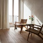 Simple Seating Corner A Couple Of Light Wood Chairs With Woven Back Wooden Side Table Vivid Houseplant On Pot