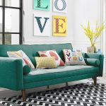 Vintage Futon Couch In Striking Turquoise Brighter Throws With Poppy Accents Herringbone Area Rug In Monochromatic Tone