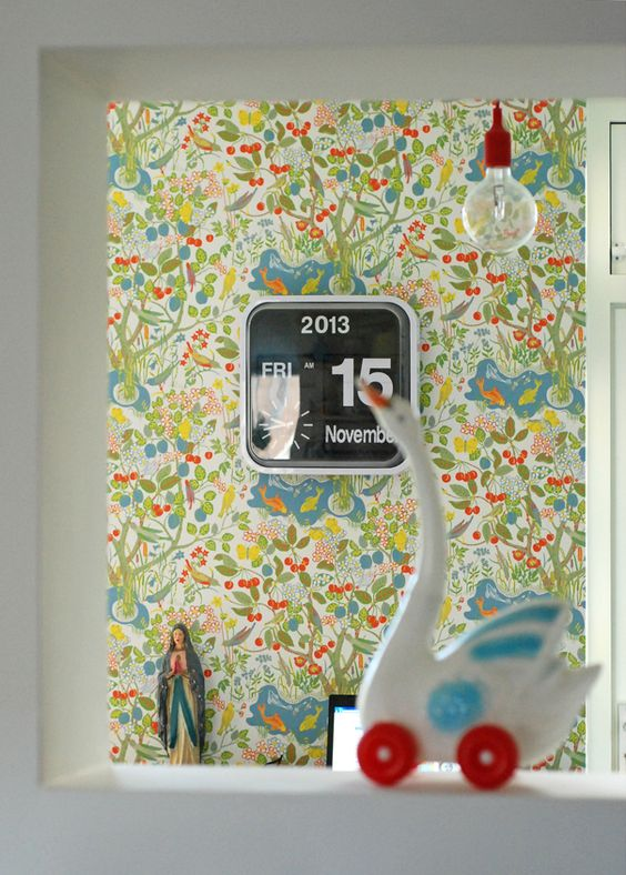vivid colored wallcovering with floral prints big digital clock