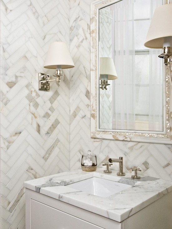 white herringbone tiles with stains marble vanity countertop with undermount sink vanity mirror with whitewashed frame