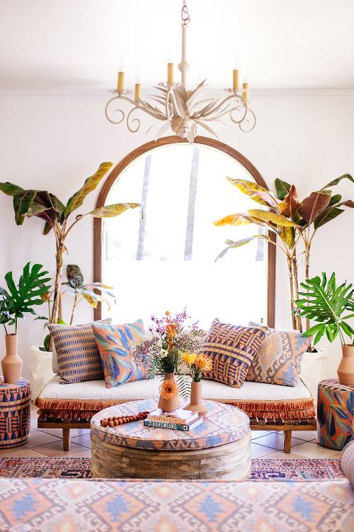 Boho living room with layers of prints and colors
