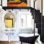 Italian Style Bathroom Idea Venetian Mirror With Artful Frames And Old Ribbon Pedestal Sink In White Clawfoot Bathtub With Black Finish Wood Floors