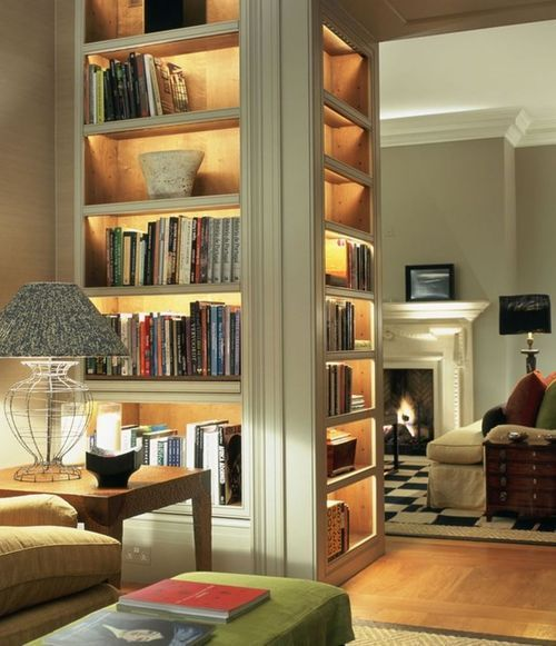 Three sided bookcase with glass door and concealed light fixtures