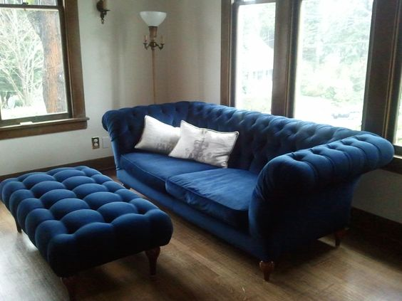 bigger tufted sofa in navy blue tufted table in navy blue