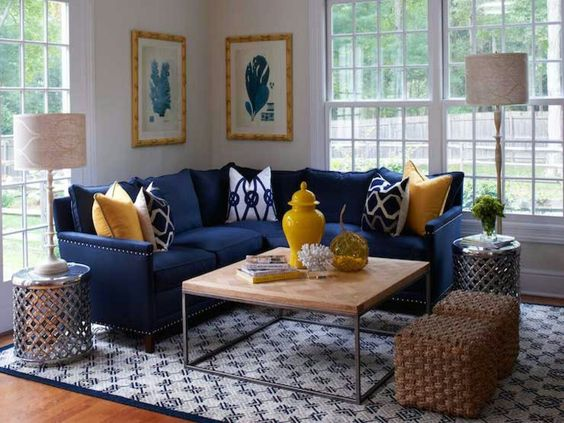 corner sofa in navy blue yellow throw pillows white navy blue throw pillows butcher block top coffee table with metal construction woven wrapped ottomans