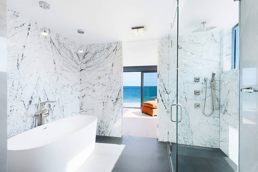 dominat white bathroom idea white marble walls white freestanding doff black floors glass shower door silver pendants