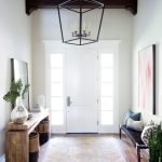 Huge Entryway Design Hardwood Console Table With Mirror On Top Glass Pot A Couple Of Woven Baskets Jute Rug Bench With Textile Cover Potted Houseplant