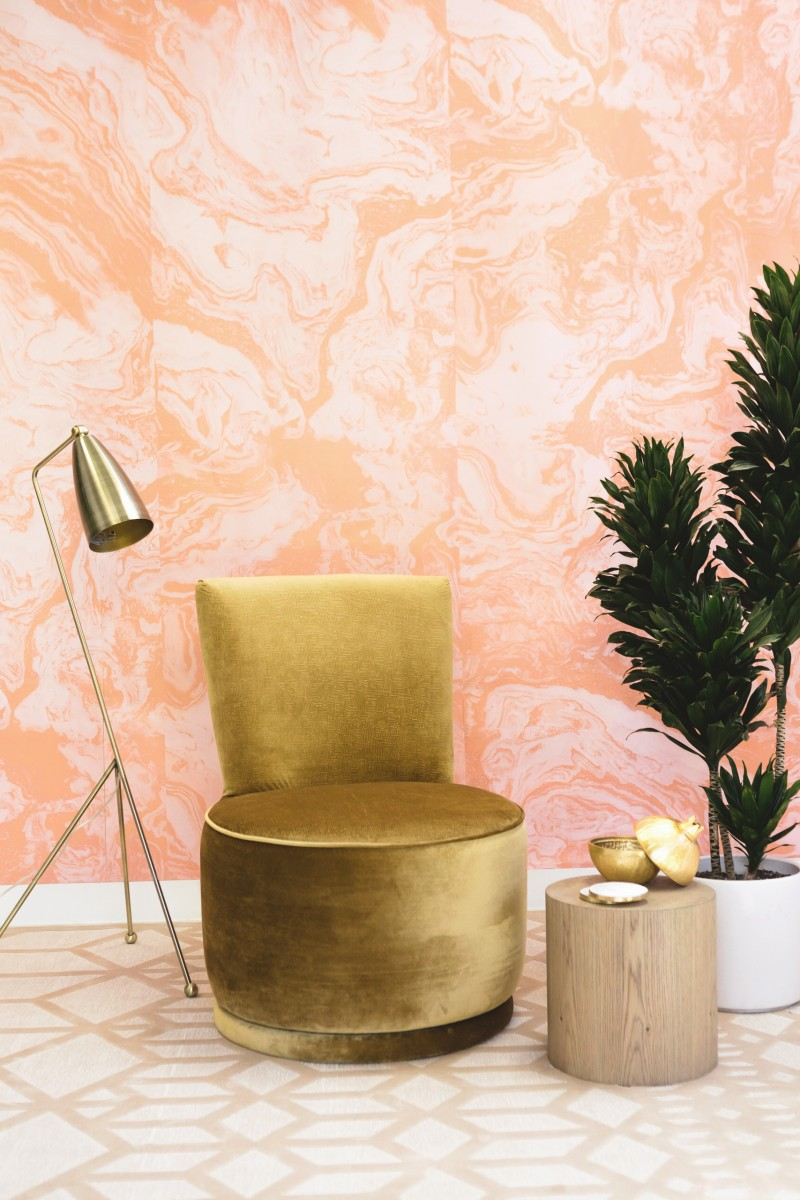 mini seating area gold tone tripod lamp gold tone chair in modern style log side table white potted houseplant pink clouds like wallpapers