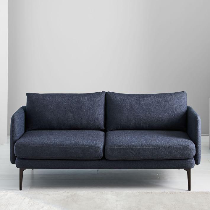modern and sleek sofa in navy blue