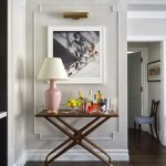 Picture Lighting Fixture With Gold Finish White Framed Oil Painting X Base Hall Console Table With Gold Finishing