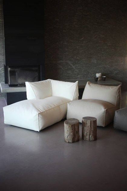simple and ergonomics sofas in white a couple of log made coffee tables