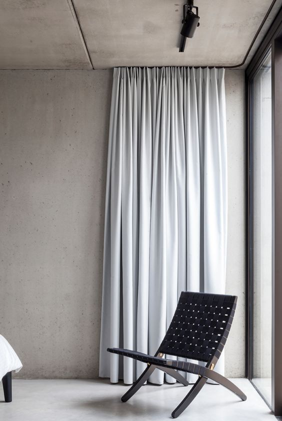 too light gray curtains folding chair in black