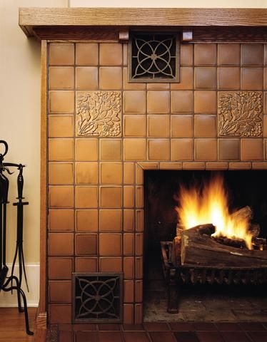 traditional fireplace with sepia tile mantel