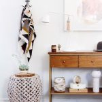 Uncluttered Entryway Wooden Hall Console Table With Drawer System And Under Open Shelf Decorative Side Table With Jute Base Multicolored Runner Abstract Oil Painting