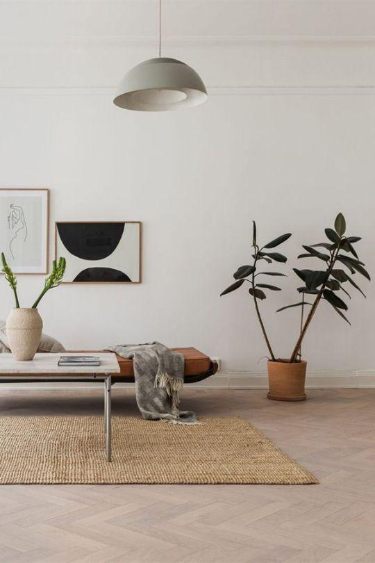 uncluttered living room minimalist furniture set clay burnt planter jute area rug huge pendant