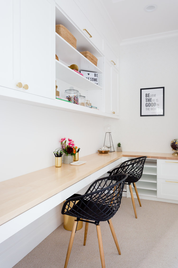working space design L shaped working table scandinavian style working chairs recessed storage units white wall paint