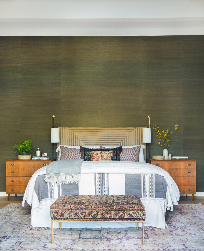 Moroccan area rug bench bed with Moroccan cover wood bedside tables with drawing system bed frame with textured headboard