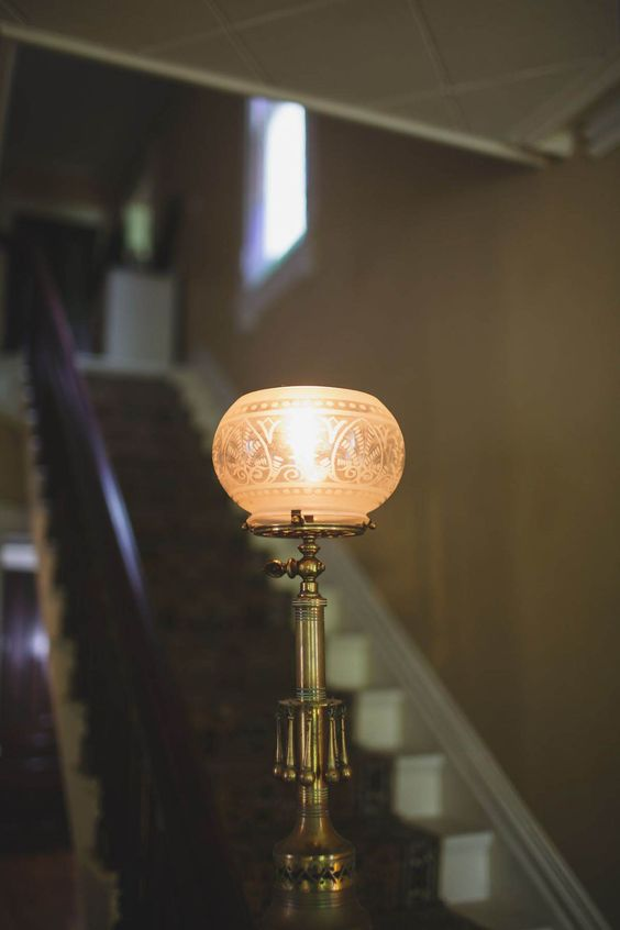 Victorian style interior light fixture with hardmetal stand and carved glass lampshade