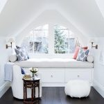 Bay Window With Curve Shape Top Built In Bench With Under Storage Solutions Floral Patterned Throw Pillows White Chair White Pouf Dark Wood Side Table With Details Of Shape