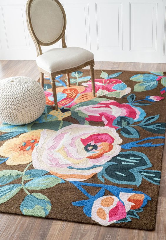 bold floral area rug in colorful tone classic chair white pouf