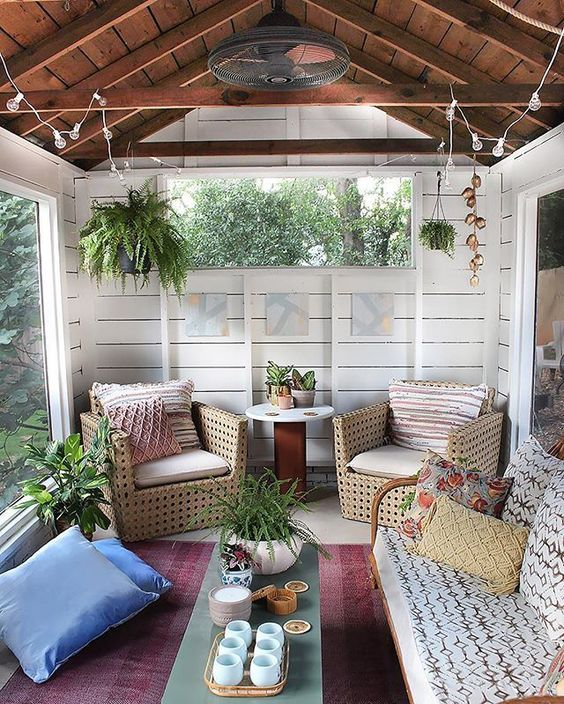 chic screen in porch for cabin rattan furniture set with upholstery red carpet some throw pillows some greenery round top side table